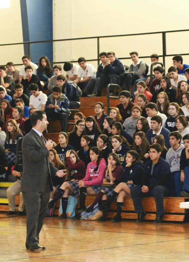 Webb County Attorney Marco Montemayor speaks to St. Augustine High School students about the prosecution of drug-related offenses during the school's Drug-Free Week Presentation Thursday afternoon. (Photo by Victor Strife/Laredo Morning Times)