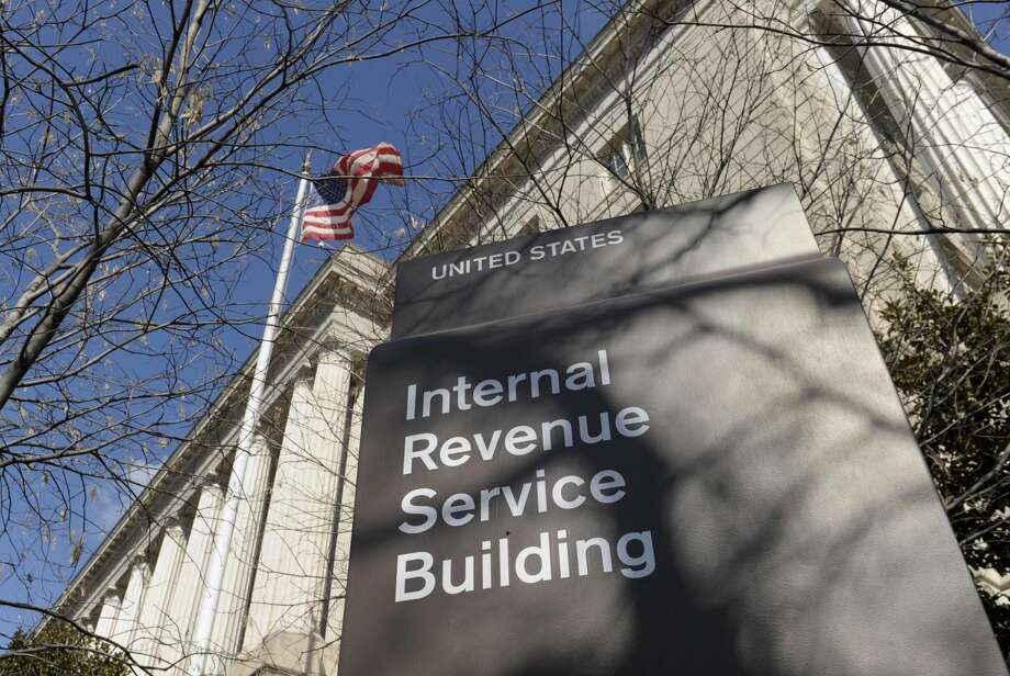 This March 22, 2013 file photo shows the exterior of the Internal Revenue Service building in Washington. The Internal Revenue Service is about to pay $70 million in employee bonuses despite an Obama administration directive to cancel discretionary bonuses because of automatic spending cuts enacted this year, according to a GOP senator. (AP Photo/Susan Walsh, File)