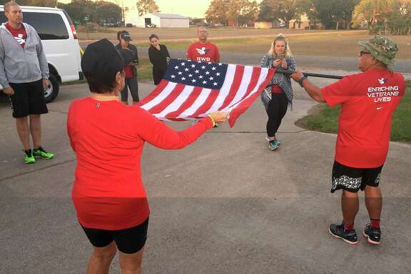 Runners participating in Team Red White and BlueÕs Old Glory Relay spent Friday running from Lissie, TX, to Richmond. The relay, which began in Redmond, WA, will pass through Houston over the weekend, before other teams of runners continue the relay to its final destination in Tampa, FL.