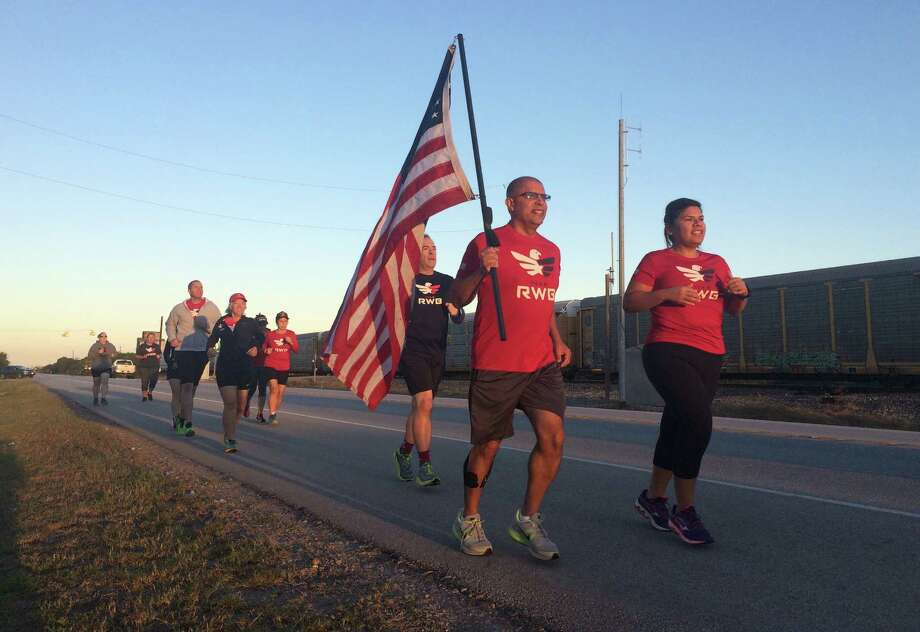 Runners participating in Team Red White and Blue's Old Glory Relay spent Friday running from Lissie, TX, to Richmond. The relay, which began in Redmond, WA, will pass through Houston over the weekend, before other teams of runners continue the relay to its final destination in Tampa, FL. Photo: St. John B Smith, Houston Chronicle / Houston Chronicle