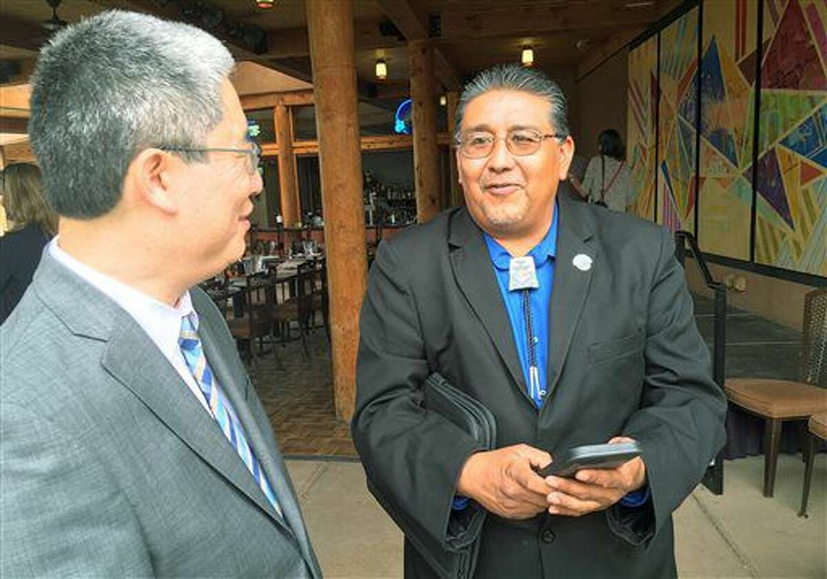U.S. Associate Deputy Attorney General Bruce Ohris, left, talks with Santa Clara Pueblo Gov. J. Michael Chavarria during a forum on opioid addiction at the Indian Pueblo Cultural Center in Albuquerque, N.M., on Tuesday, Sept. 20, 2016. American Indian tribal leaders from northern New Mexico, an area of the country devastated by heroin and opioid addiction, met with the U.S. Justice Department on Tuesday over ways to combat opioid abuse amid high overdose deaths among Native Americans. (AP Photo/Russell Contreras)