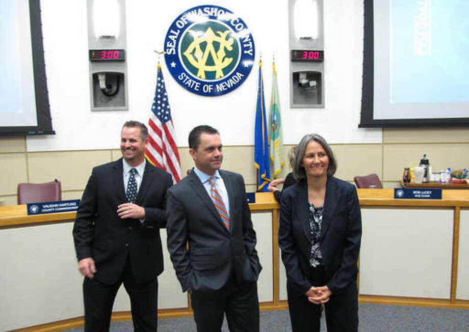 Dominic Brunetti, from left, Jesse Haw, and Julia Ratti prepare to talk to reporters after the Washoe County Commission appointed them to interim seats in the Nevada Legislature for an anticipated special session next month, Tuesday, Sept. 27, 2016, in Reno, Nev. The three northern Nevadans, including a former Stanford University football player, were appointed Tuesday for a special session to consider raising hotel room taxes in the Las Vegas area to help pay for a $1.9 billion NFL stadium that could attract the Oakland Raiders to the city. (AP Photo/Scott Sonner)