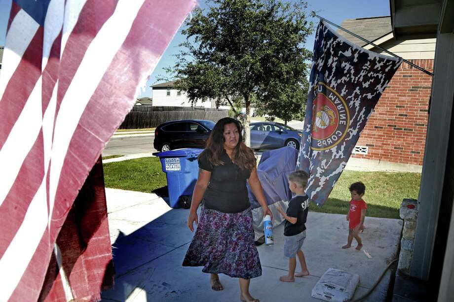 Yvonne Brinkley and her husband decided to live in the South Side when they moved to San Antonio from California in 2012. They were attracted by its low home prices and its abundance of green space. Photo: Ron Cortes /For The San Antonio Express-News
