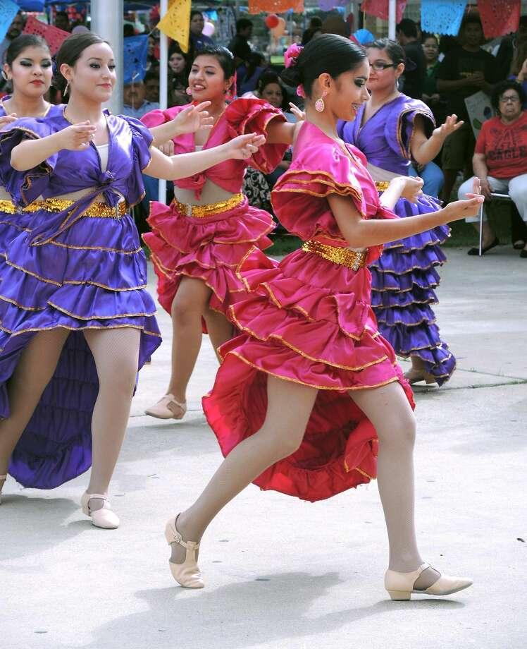 Vidal M. Treviño School of Communications & Fine Arts students dance before family, friends and fellow students as they participate in the 20th Annual Hispanic Heritage Festival at the Laredo Civic Center Grounds Wednesday. (Photo by Cuate Santos/Laredo Morning Times)