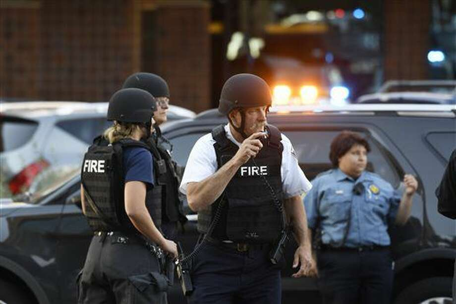 A Denver hospital complex was placed on lockdown Friday, Sept. 16, 2016, after a report that a man was seen carrying a rifle on the complex grounds. There was no confirmation that shots had been fired or anyone was injured at Rose Medical Center, police spokeswoman Raquel Lopez said. Hospital officials say no one there was hurt. (Andy Cross/The Denver Post via AP)