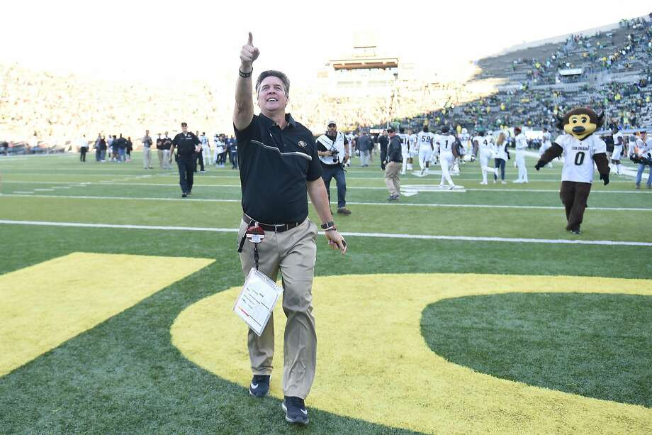 Mike MacIntyre leaves the field at Oregon, above, with a 41-38 win last month. What's he's accomplished with Colorado is no surprise to those who saw his success at San Jose State (celebrating a 2012 win, below, with cornerback Jimmy Pruitt). Photo: Steve Dykes, Getty Images
