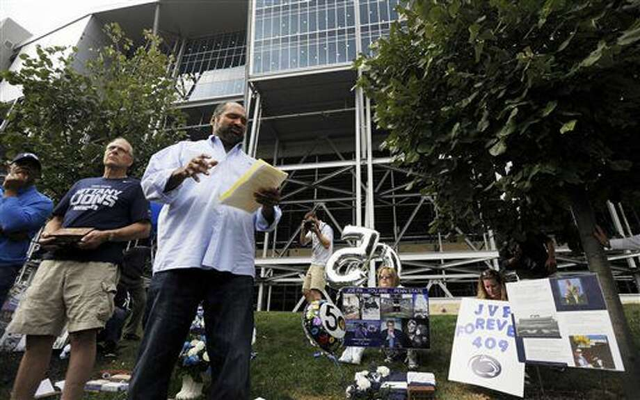 Former Penn State football player Franco Harris speaks about the late Joe Paterno before an NCAA college football game between Penn State and Temple, Saturday, Sept. 17, 2016, at State College, Pa. Penn State defeated Temple 34-27, and celebrated the 50th anniversary of former head coach Joe Paterno's first game by honoring members of the 1966 football team and showing video tributes on the scoreboard. (Phoebe Sheehan/Centre Daily Times via AP)