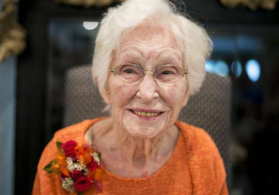 In this Sept. 12, 2016 photo, former model Audrey Gallagher smiles during a celebration of her 105th birthday at Sheffield Bay Assisted Living, in Bay City, Mich. (Jacob Hamilton/The Bay City Times via AP)