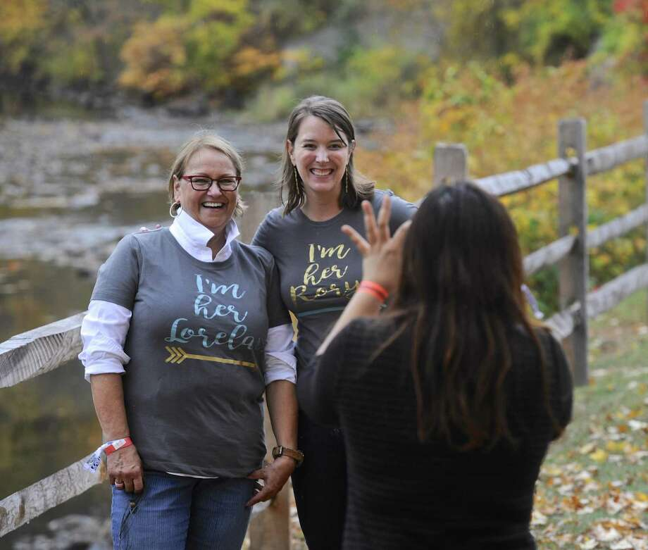 """Hanna Aardema, left, and her daughter Jill Vanderwall, of Indianapolis, IN, pose for a photo at the Gilmore Girls Fan Fest in Washington Depot, Conn, on Friday, October 21, 2016. Sophia Guire, of New York, NY, takes the photo. They are wearing t-shirts that say """" Im her Lorelai"""" and """"I'm her Rory"""" referring to the mother and daughter characters in the Gilmore Girls tv show. Photo: H John Voorhees III / Hearst Connecticut Media / The News-Times"""