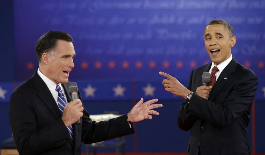 In this Oct. 16, 2012 photo, President Barack Obama and Republican presidential candidate, former Massachusetts Gov. Mitt Romney exchange views during the second presidential debate at Hofstra University in Hempstead, N.Y.(AP Photo/David Goldman, File)