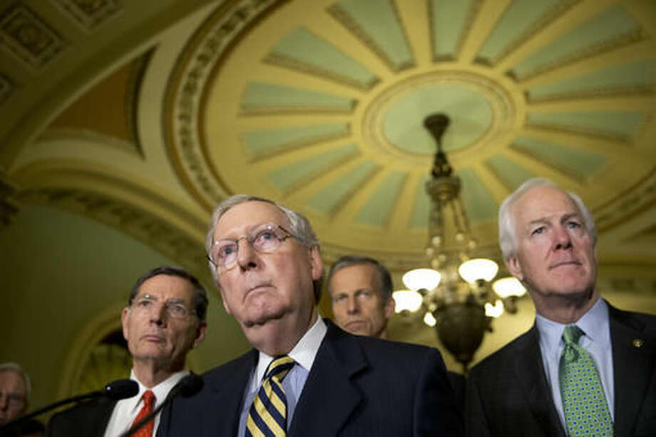 FILE - In tis June 21, 2016, file photo, Senate Majority Leader Mitch McConnell of Ky., accompanied by, from left, Sen. John Barrasso, R-Wyo., Sen. John Thune, R-S.D., and Senate Majority Whip John Cornyn of Texas, listen to a question during a news conference on Capitol Hill in Washington. Democrats opened a last-minute push Tuesday, Sept. 27, for new talks on must-do legislation to prevent the government from shutting down this weekend, fight the Zika virus and help flood-ravaged Louisiana rebuild. The aim is to see if Republicans will relent and add money to help Flint, Mich., with its water crisis — and get Capitol Hill off a collision course that could lead to a government shutdown this weekend. (AP Photo/Alex Brandon, File)