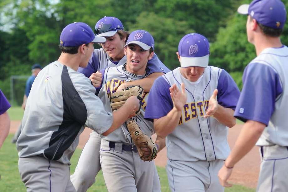 Westhill's Tyler Rich is congratulated by his teammates after making the throw for an out at home as the Westhill High School baseball team hosts Stamford High School in baseball action in Stamford, Conn. on Friday May 14, 2010. Photo: Kathleen O'Rourke / Stamford Advocate