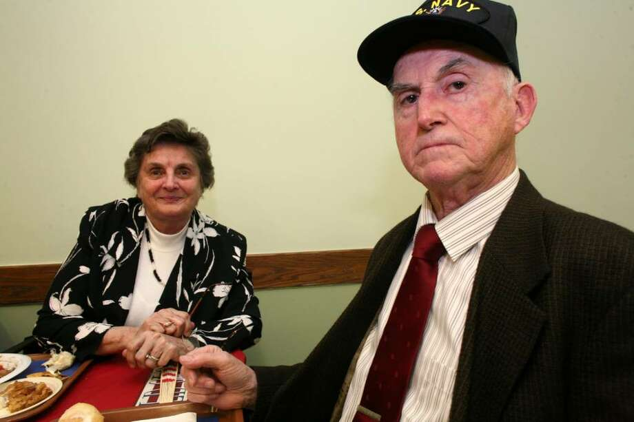 Korean War veteran Walter Casey and his wife Doris attend Friday evening's USO party at the Greenwich Senior Center in honor of National Armed Forces Day, which is Saturday. Photo: David Ames, David Ames/For Greenwich Time / Greenwich Time