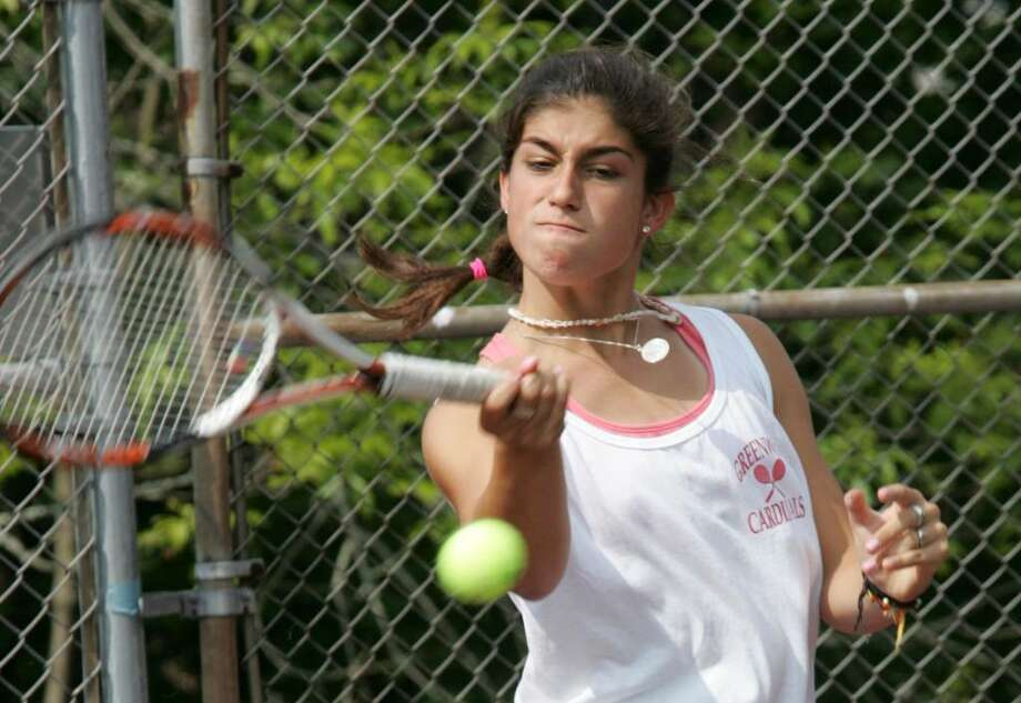 Greenwich High School number one singles tennis player Jen DeLuca in action against New Canaan's Tina Tehrani Friday afternoon. Photo: David Ames, David Ames/For Greenwich Time / Greenwich Time