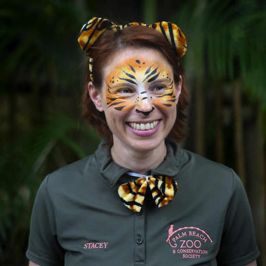 FILE- In this March 7, 2015, file photo, Stacey Konwiser smiles during the dedication of the new tiger habitat at the Palm Beach Zoo in West Palm Beach, Fla. Stacey Konwiser screamed for help into her radio before she was fatally attacked by a Malayan tiger, but the 350-pound animal crushed her neck before her co-workers could reach her, an autopsy report released Friday, Sept. 23, 2016. (Brianna Soukup/Palm Beach Post via AP, File)