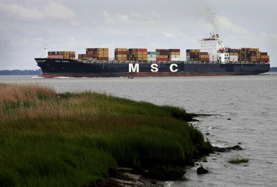 In this Saturday, Aug. 11, 2012, photo, the container ship MSC Emma heads up the Delaware River towards the Port of Philadelphia. The U.S. trade deficit widened in August 2012 as exports fell to the lowest level in six months, a worrisome sign that a slowing global economy is cutting into demand for U.S. good (AP Photo/Mark Lennihan)