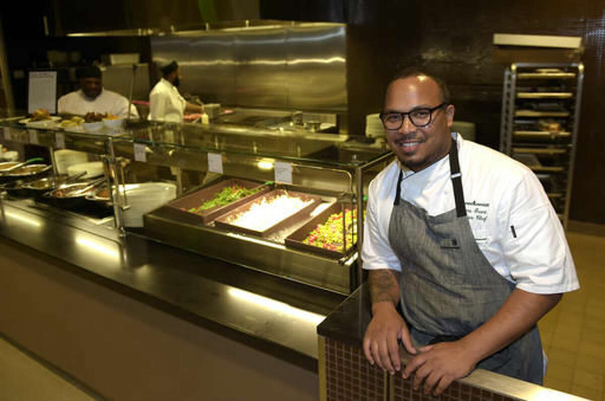 FILE - In tis Sept. 14, 2016 file photo, chef Jerome Grant poses for a photo inside the North Star Cafe at the National Museum of African American History and Culture in Washington. The museum, opening later this month, will be an experience aimed at feeding the soul, literally. The Sweet Home Cafe is the museum's restaurant, with a menu featuring culturally authentic fare and modern-day-inspired foods. The restaurant is a journey through the agricultural south, Creole coast, northern states and the Southwest. (AP Photo/Susan Walsh, File)