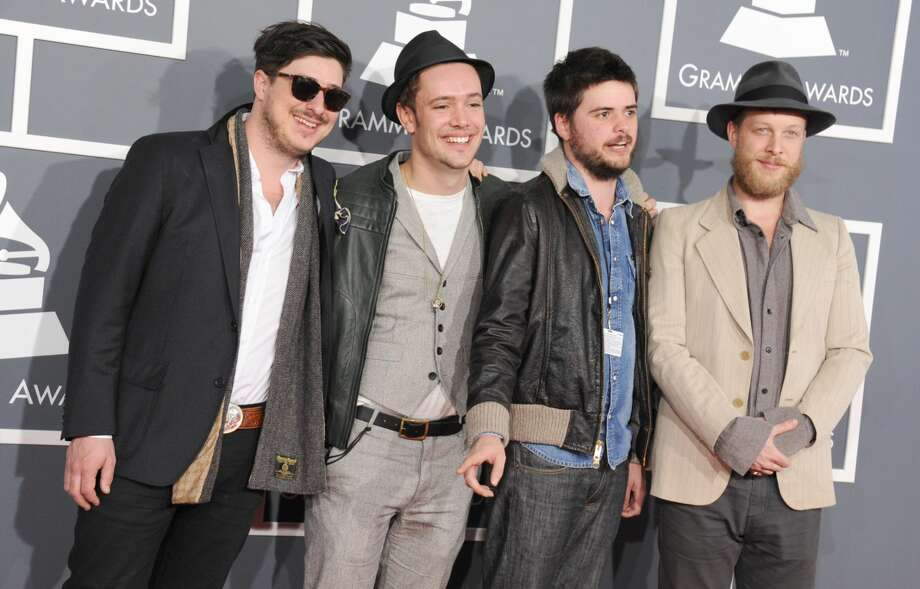 This Feb. 10, 2013 file photo shows, from left, Marcus Mumford, Ben Lovett, Country Winston and Ted Dwane, of Mumford & Sons, at the 55th annual Grammy Awards in Los Angeles. The Grammy-winning band announced Monday, June 24, rescheduled dates in Dallas, Woodlands, New Orleans and Kansas City. The upcoming shows will include bassist Ted Dwane, who received treatment for a blood clot on his brain two weeks ago. (Photo by Jordan Strauss/Invision/AP, file)