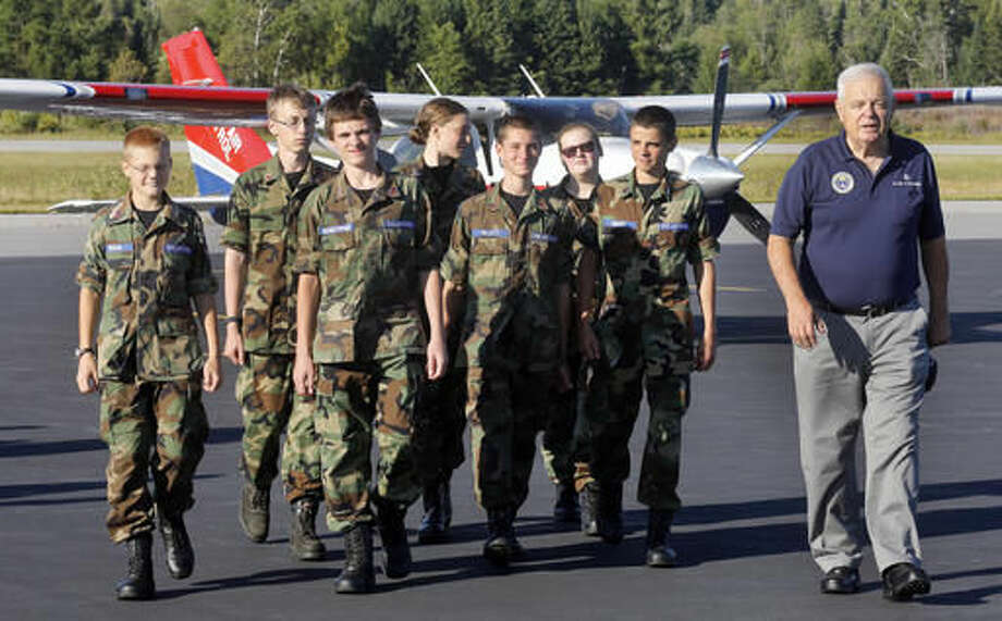 In this photo taken Wednesday Sept. 7, 2016 Squadron Commander Allen Strasser with with a group of new Civil Air Patrol cadets at the Mount Washington Regional Airport in Whitefield, N.H. A renewed interest in flying has led to the return of a volunteer Civil Air Patrol unit in northern New Hampshire. (AP Photo/Jim Cole)