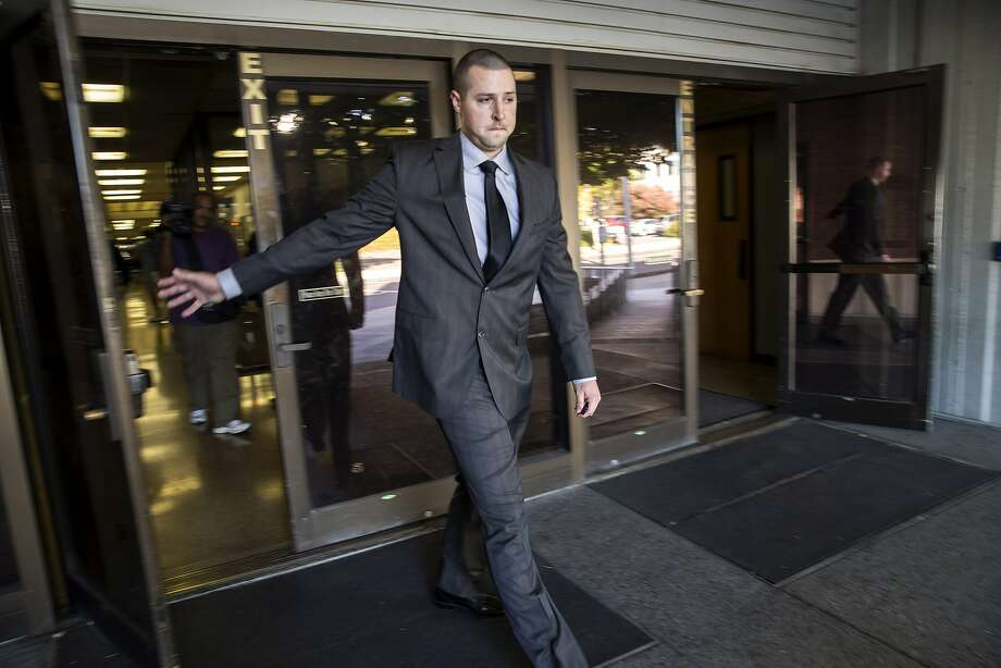 FILE -- Oakland police officer Ryan Walterhouse exits the Hayward Hall of Justice, following his arraignment in this Friday, Oct. 21, 2016 file photo. Photo: Santiago Mejia, The Chronicle