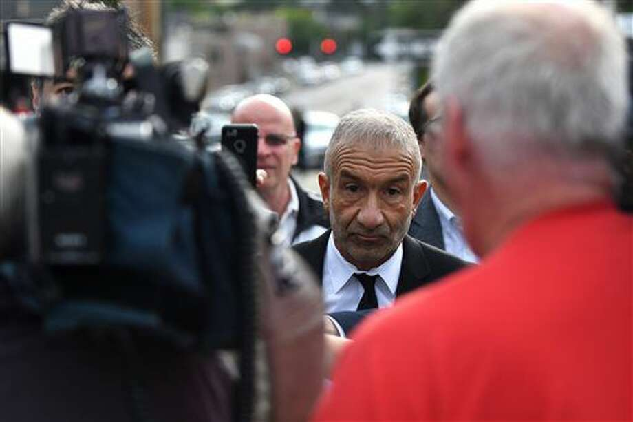 Alain Kaloyeros, president of SUNY Polytechnic Institute leaves Albany City Courthouse following his arraignment on state charges on Friday, Sept. 23, 2016, in Albany, N.Y. The state complaint alleges Kaloyeros agreed to steer construction contract awards to hand-picked companies. (Will Waldron/The Albany Times Union via AP)