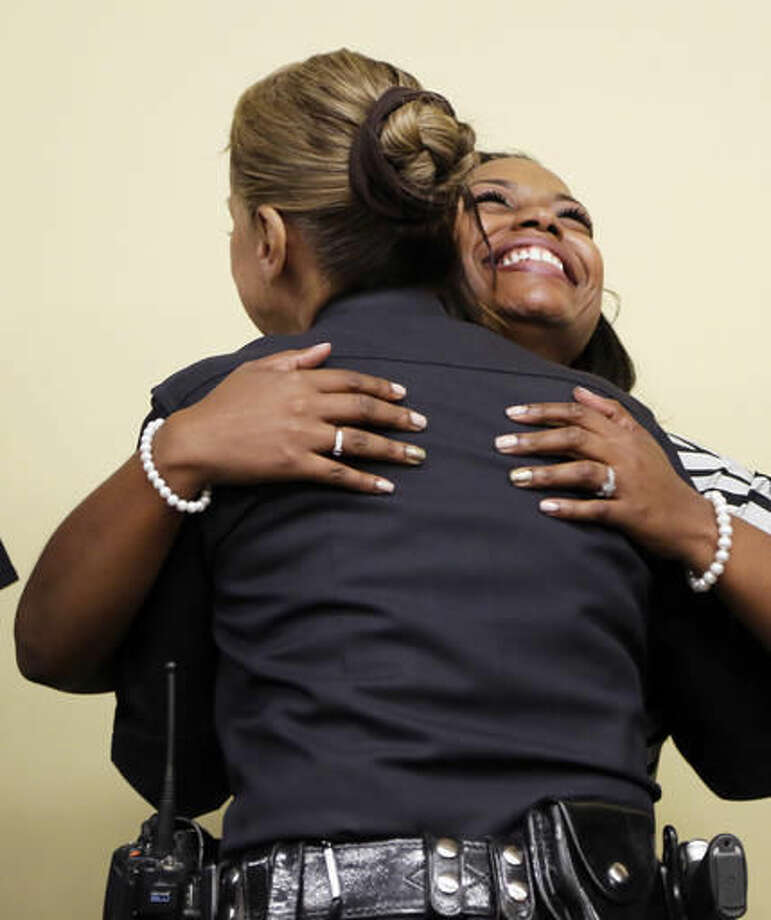 Rodney King's daughter Lora King, 32, and Los Angeles Police Capt. Ruby Flores embrace as they meet with a group of young people who have had their own run-ins with police at a meeting of the Los Angeles Conservation Corps, which provides at-risk youth with job training, education and work, in downtown Los Angeles Thursday, Sept. 15, 2016. She was just 7 when her father was beaten by the Los Angeles Police Department. Her message: It's more important to build bridges with officers than to stand against the, and that a whole police department can't be judged by the actions of a few.(AP Photo/Reed Saxon)