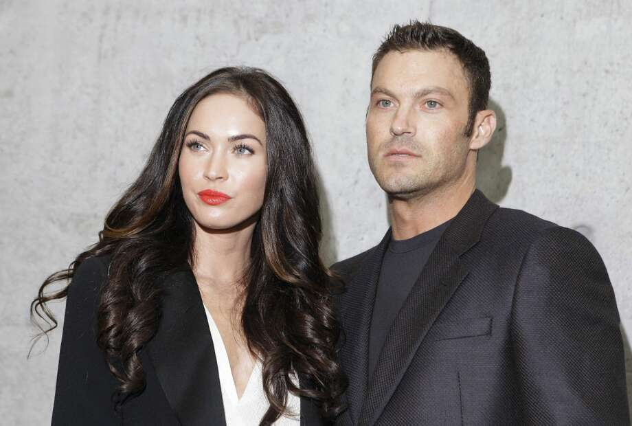 This Sept. 25, 2010 file photo shows American actress Megan Fox posing with her husband Brian Austin Green after watching the presentation of the Emporio Armani Spring-Summer 2011 fashion collection, during the fashion week in Milan, Italy. wrote on her Facebook profile on Wednesday that she and husband Brian Austin Green welcomed a son named Noah Shannon Green on Sept. 27. (AP Photo/Luca Bruno, file)