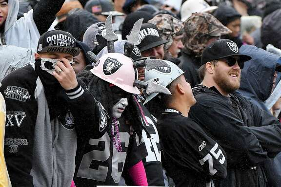 The Oakland Raiders Black Hole fan section in the fourth quarter during a game against the Kansas City Chiefs on Sunday, Oct. 16, 2016 at O.co Coliseum in Oakland, Calif. (John Sleezer/Kansas City Star/TNS)
