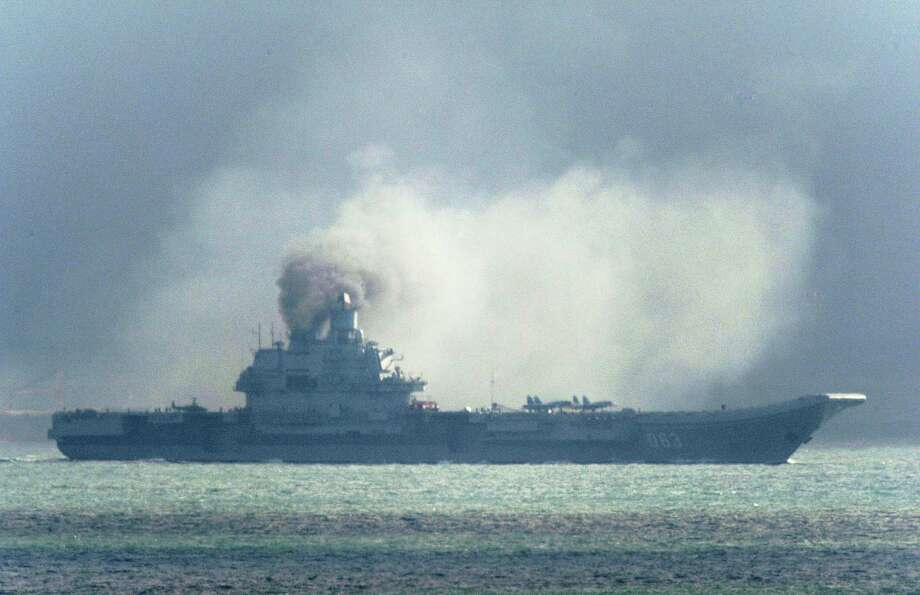 The Russian aircraft carrier Admiral Kuznetsov passes Friday within a few miles of Dover, England as a fleet of Russian warships sails through the North Sea. Photo: Gareth Fuller, SUB / PA