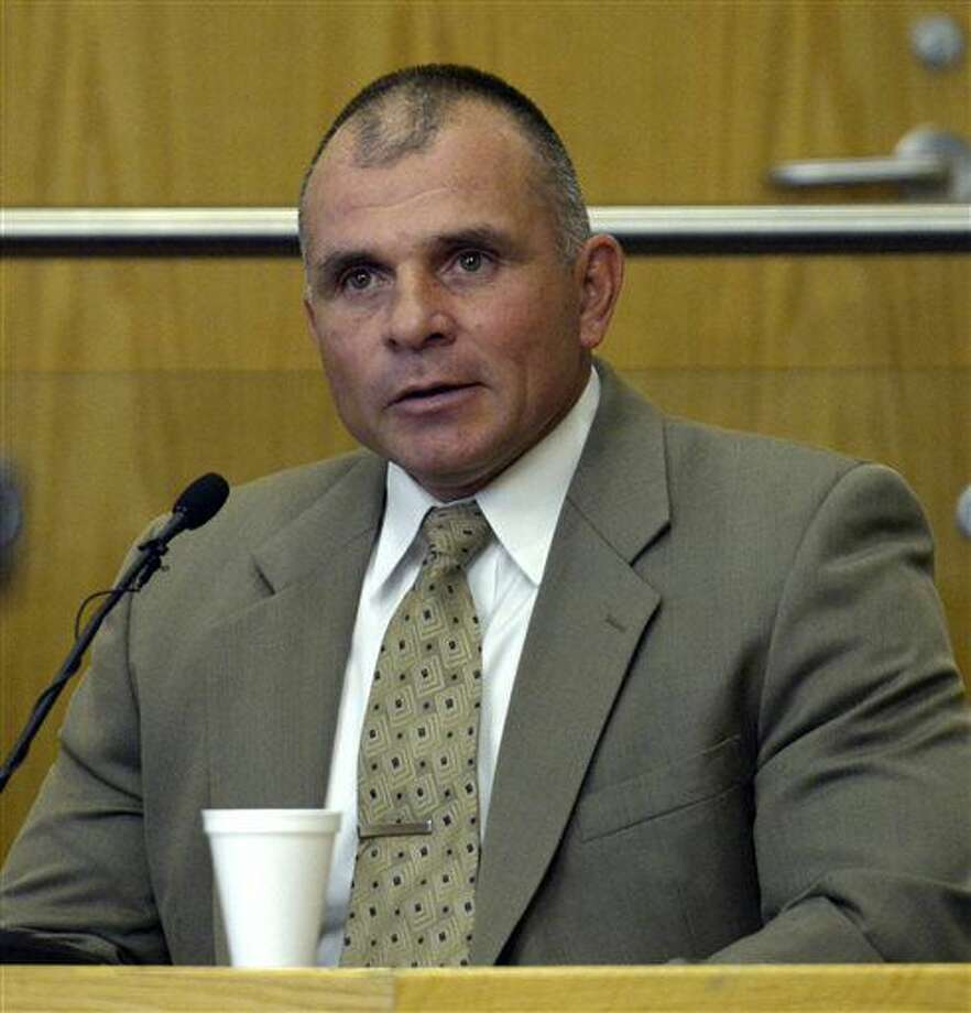 In this Monday, Sept. 26, 2016, photo, former New Mexico State Police Sgt. Scott Ware testifies during the trial of now-retired Detective Keith Sandy and former Officer Dominique Perez in the shooting death of homeless camper James Boyd in District Court in Albuquerque, N.M. (Greg Sorber/The Albuquerque Journal via AP, Pool)