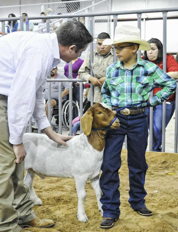 Jonathan Martinez showcases his goat during the Zapata County Fair on Friday afternoon at the Zapata Fair Grounds. (Ulysses S. Romero/Laredo Morning Times)