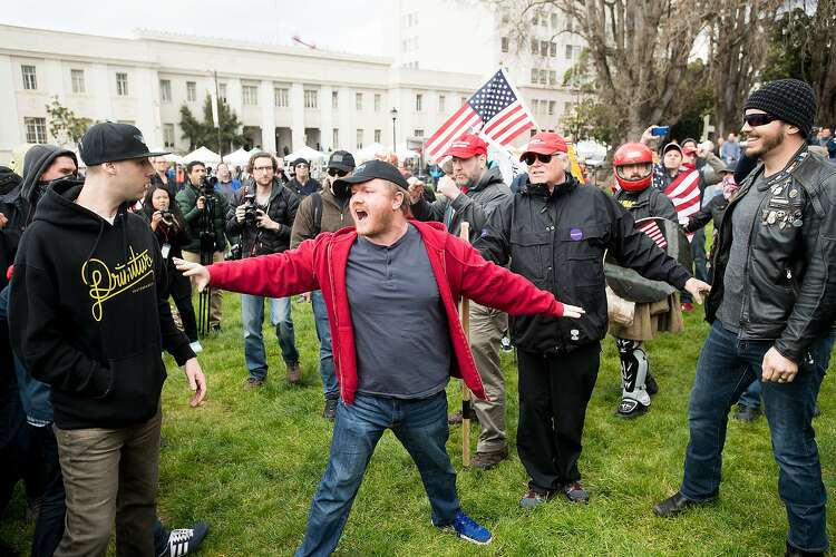 9e4edb26 A man tries to separate protesters for and against President Donald Trump  in Berkeley. Noah Berger, Special To The Chronicle