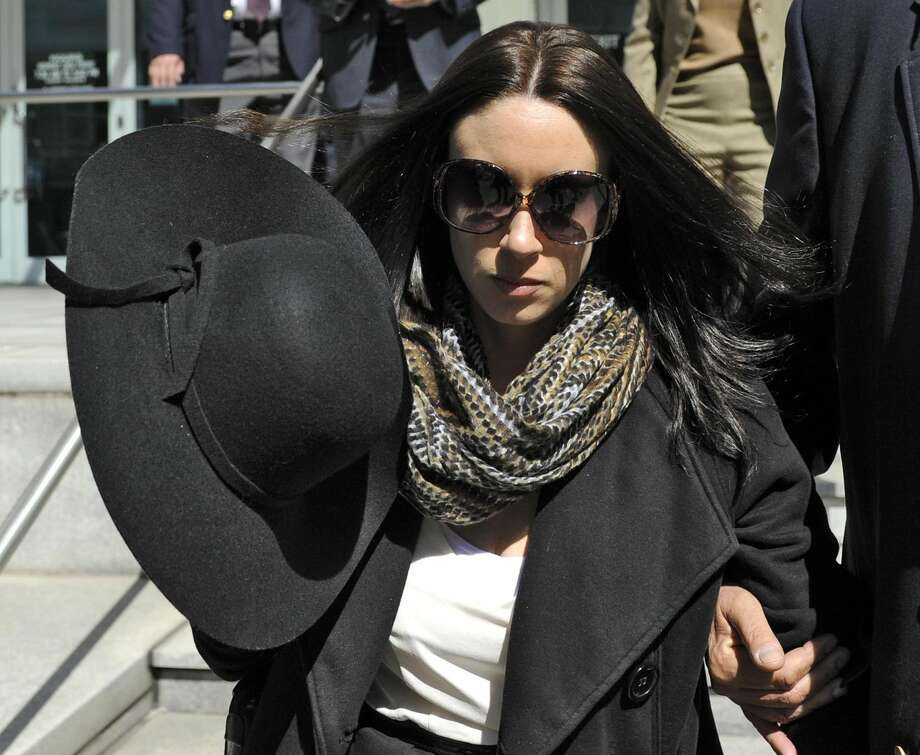 """In this Monday, March 4, 2013 file photo, Casey Anthony leaves the federal courthouse in Tampa, Fla., after a bankruptcy hearing. The trustee overseeing Casey Anthony's bankruptcy case has filed a motion to sell the rights to her story so she can pay her debts. In a motion filed Friday, March 18, 2013, in federal court in Tampa, Fla., trustee Stephen Meininger asked Judge K. Rodney May for permission to sell the """"exclusive worldwide rights"""" of Anthony's life story. (AP Photo/Brian Blanco, File)"""