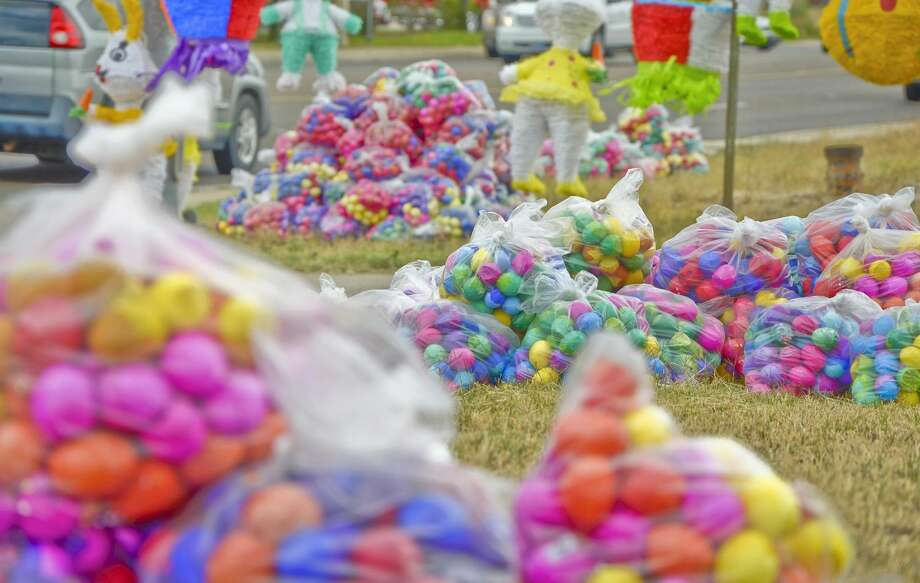 """Piles of bags filled with Easter eggs, or """"cascarones,"""" sit on the side of the road, where vendors set up shop Friday afternoon at the intersection of McPherson and Jacaman roads. (Photo by Danny Zaragoza/Laredo Morning Times)"""