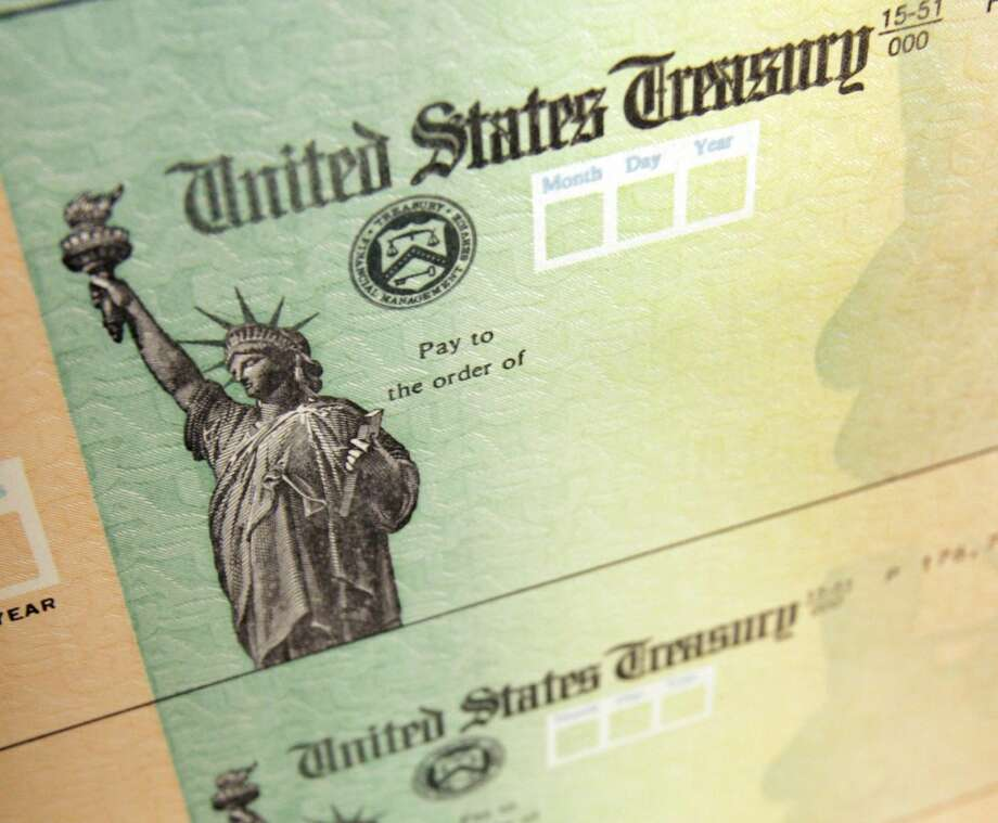 In this May 8, 2008, file photo, blank U.S. Treasury checks are seen on an idle press at the Philadelphia Regional Financial Center, which disburses payments on behalf of federal agencies. If you didn't bother filing a federal tax return for 2009, it might be a good time to rethink your tax strategy. The Internal Revenue Service says it has $917 million in unclaimed tax refunds from 2009, and time is running out to claim them. The refunds are owed to nearly 1 million people who failed to file returns for 2009. (AP Photo/Matt Rourke, File)