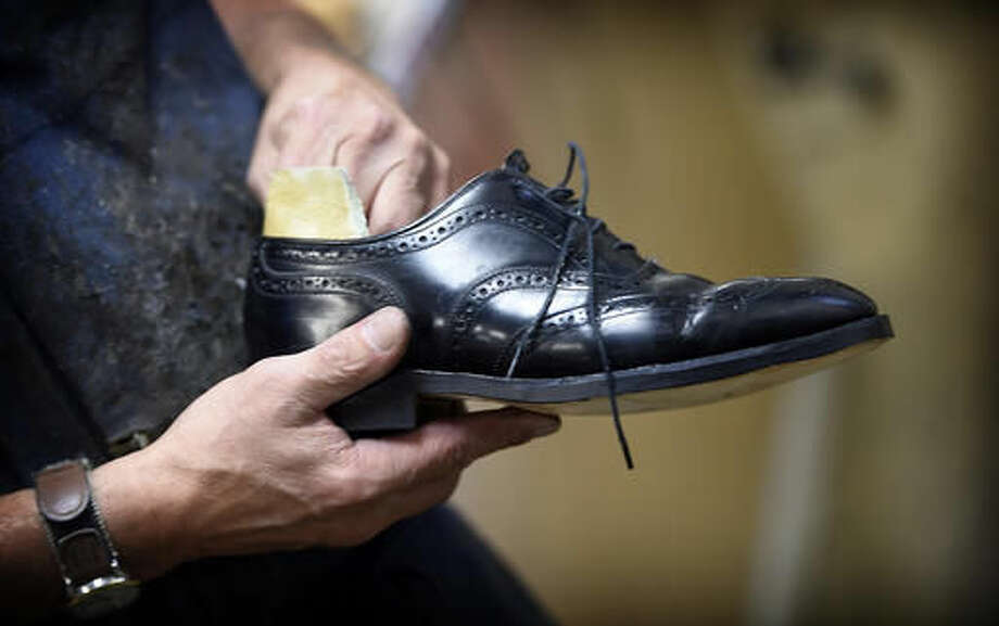 In an Aug. 30, 2016 photo, current owner of Dinunzio's Shoe Repair, Dave Dinunzio, a third generation shoe repairman, still operates the business his grandfather, John Dinunzio started in Lebanon, Pa. Dinunzio's Shoe Repair will celebrate being in business 100 years on Wednesday, Sept. 7, 2016. (Michael K. Dakota/Lebanon Daily News via AP)