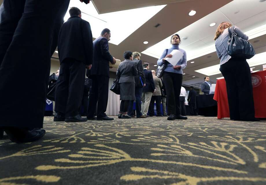 In this Monday, Feb. 25, 2013, photo, job seekers line up to speak with a State Dept. employee about job opportunities in the federal government during a job fair in Boston. market. Weekly unemployment benefit applications rose just 2,000 to a seasonally adjusted 336,000, the Labor Department said Thursday, March, 21, 2013. Over the past four weeks, the average number of applications has dropped by 7,500 to 339,750. That's the lowest since February 2008, just three months into the recession. (AP Photo/Michael Dwyer)