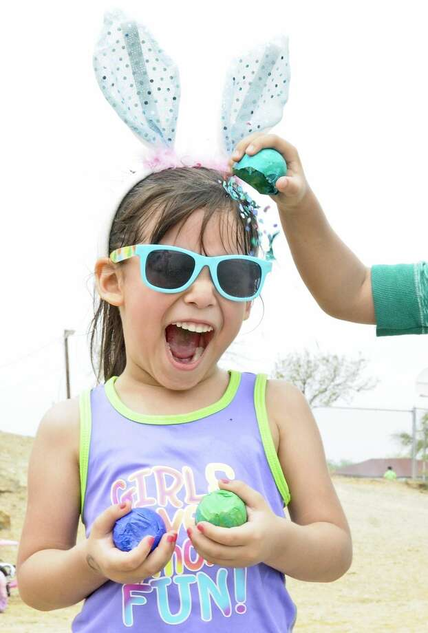 Madison Ruiz reacts as her friend cracks an Easter egg on her head at Lake Casa Blanca on Easter Sunday. Thousands of people flock to the lake every year to enjoy the day. (Photo by Ulysses S. Romero/Laredo Morning Times)