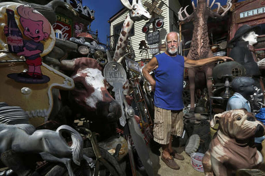 Jerry Lotz stands with some of the antiques at his home in Louisville, Ky., on Sept. 12, 2016. Lotz has been collecting unique items for over five decades. (Pat McDonogh/The Courier-Journal via AP)
