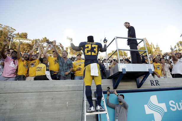 California running back Vic Enwere celebrates with fans after a 28-23 win over Utah during an NCAA college football game Saturday, Oct. 1, 2016, in Berkeley, Calif. (AP Photo/Marcio Jose Sanchez)