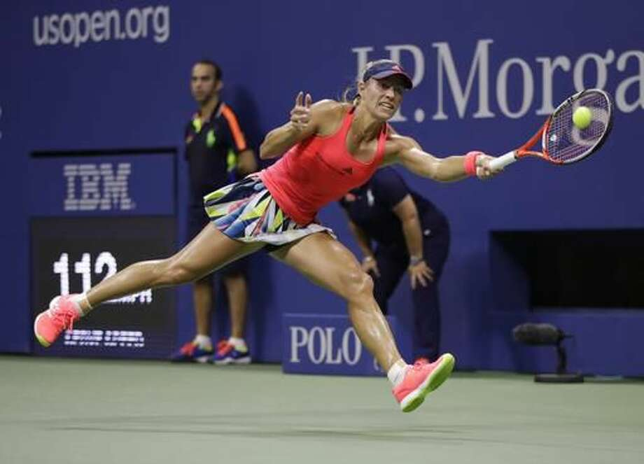 Angelique Kerber, of Germany, returns a shot to Caroline Wozniacki, of Denmark, during the semifinals of the U.S. Open tennis tournament, Thursday, Sept. 8, 2016, in New York. (AP Photo/Julio Cortez)