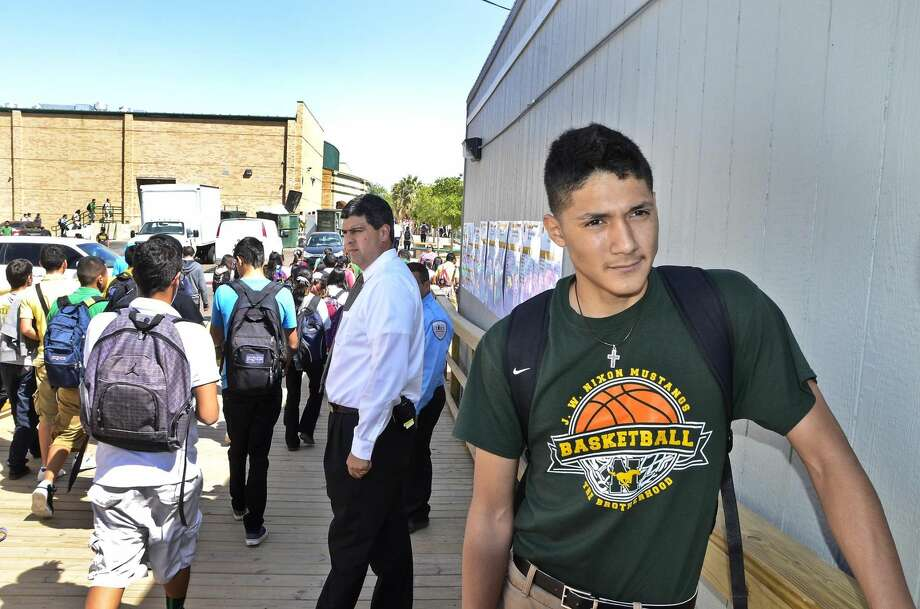 Nixon High School student Rolando Bustamante talks about his first-day experience in Nixon High School's portable campus Monday afternoon. Students will attend classes in portable buildings while the district demolishes the old buildings and constructs a modern campus. (Photo by Cuate Santos/Laredo Morning Times)