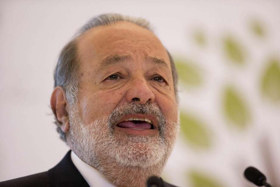 In a Monday, Jan. 14 file photo, Mexican telecommunications tycoon Carlos Slim speaks during news conference at the Soumaya museum in Mexico City. Forbes magazine says Monday, March 4, 2013, that Mexico's Carlos Slim remains the world's richest man for the fourth year in a row, while Warren Buffett dropped out of the top three for the first time since 2000. (AP Photo/Dario Lopez-Mills, File)