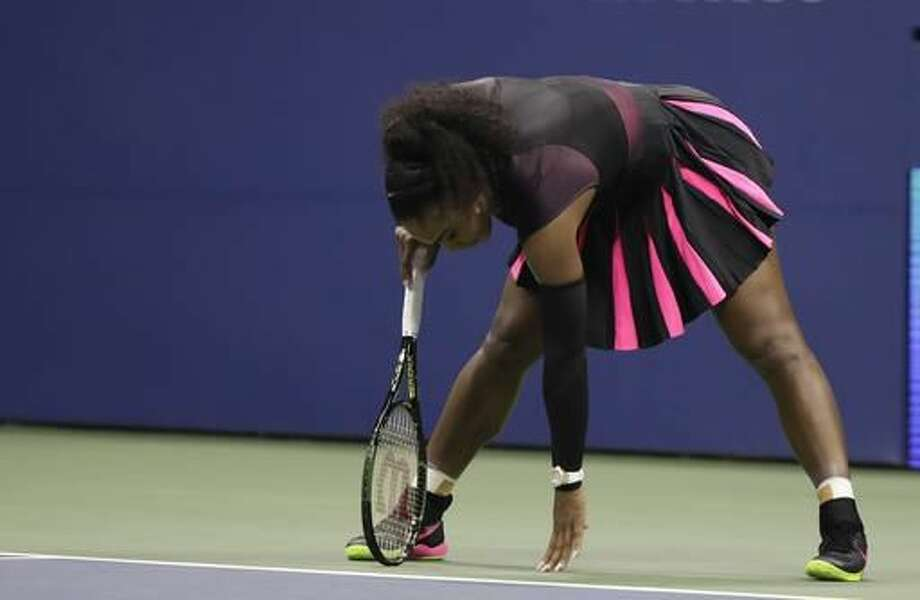 Serena Williams catches her balance after a serve from Karolina Pliskova, of the Czech Republic, during the semifinals of the U.S. Open tennis tournament, Thursday, Sept. 8, 2016, in New York. (AP Photo/Darron Cummings)