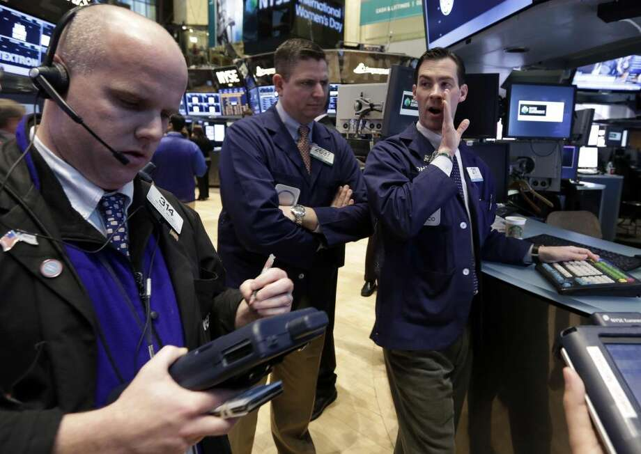 Specialist John McNierney, right, works on the floor of the New York Stock Exchange Friday, March 8, 2013. Stocks are opening higher on Wall Street after the government reported a burst of hiring last month that sent the unemployment rate to a four-year low. (AP Photo/Richard Drew)