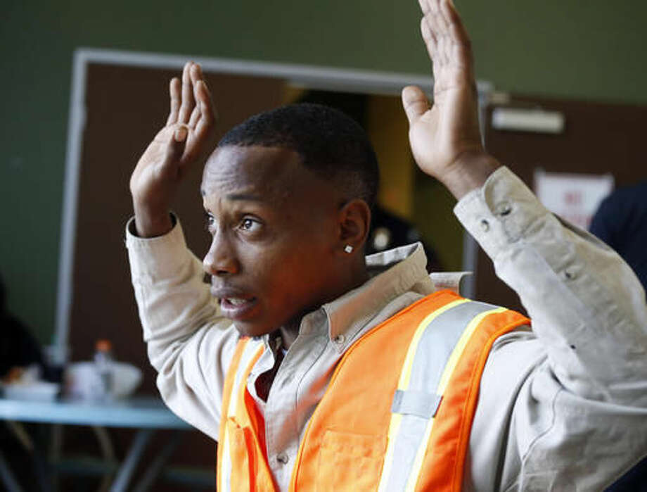 During a visit by Rodney King's daughter Lora King, not shown, to the Los Angeles Conservation Corps, one among a group of young people who have had their run-ins with police, Lovis Bell, 23, talks about his own experience with the Los Angeles Police Department at a meeting in downtown Los Angeles Thursday, Sept. 15, 2016. Bell was 16 and fighting Hodgkin's lymphoma when he said two officers stopped him and his friends as they were walking in South Los Angeles. Without warning, as they were being questioned, Bell said one of the officers slammed him into a gate, crushing a catheter in his chest that delivered his chemotherapy. (AP Photo/Reed Saxon)