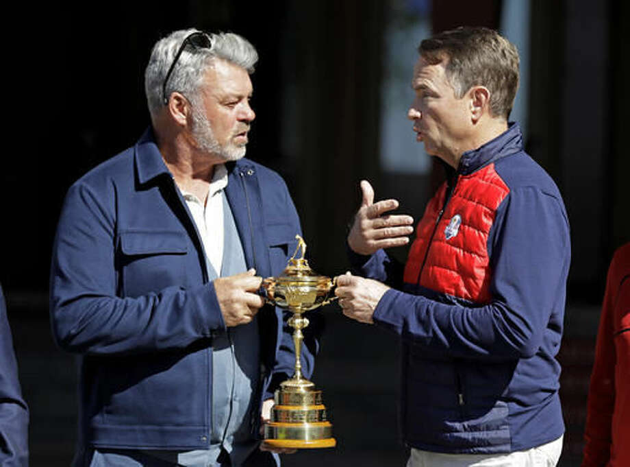Europe captain Darren Clarke, left, and United States captain Davis Love III pose with the Ryder Cup Monday, Sept. 26, 2016, at Hazeltine National Golf Club in Chaska, Minn. (AP Photo/David J. Phillip)