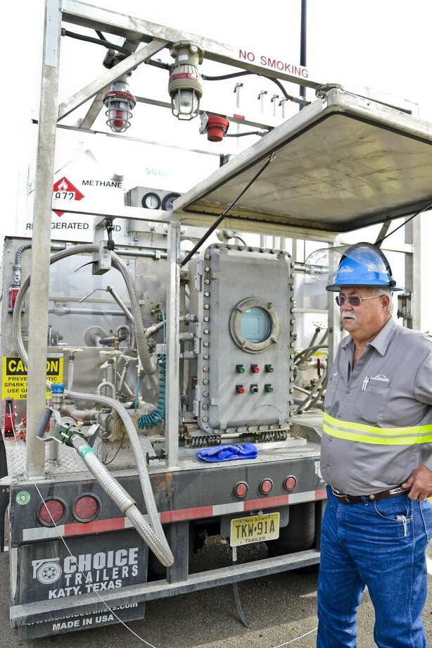Linde truck driver Howard Sanford, stands next to a portable refueling station for vehicles that operate on natural gas as opposed to regular gasoline, Tuesday afternoon outside of Uni-Trade Stadium during the South Central Texas Natural Gas Vehicle Consortium Meeting. (Photo by Danny Zaragoza/Laredo Morning Times)