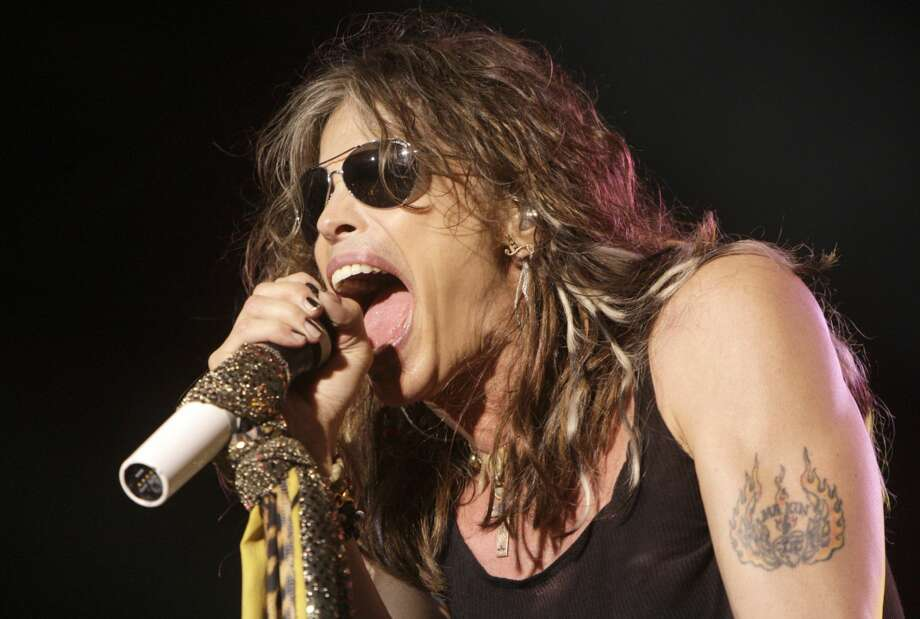 In this June 10, 2009 file photo, vocalist Steven Tyler, of the rock band Aerosmith, performs at the Verizon Wireless Amphitheater in Maryland Heights, Mo. Tyler plans to attend a legislative hearing in Hawaii on Friday, Feb. 8, 2013, on a bill that bears his name and would limit people's freedom to take photos and video of celebrities. (AP Photo/Jeff Roberson, File)
