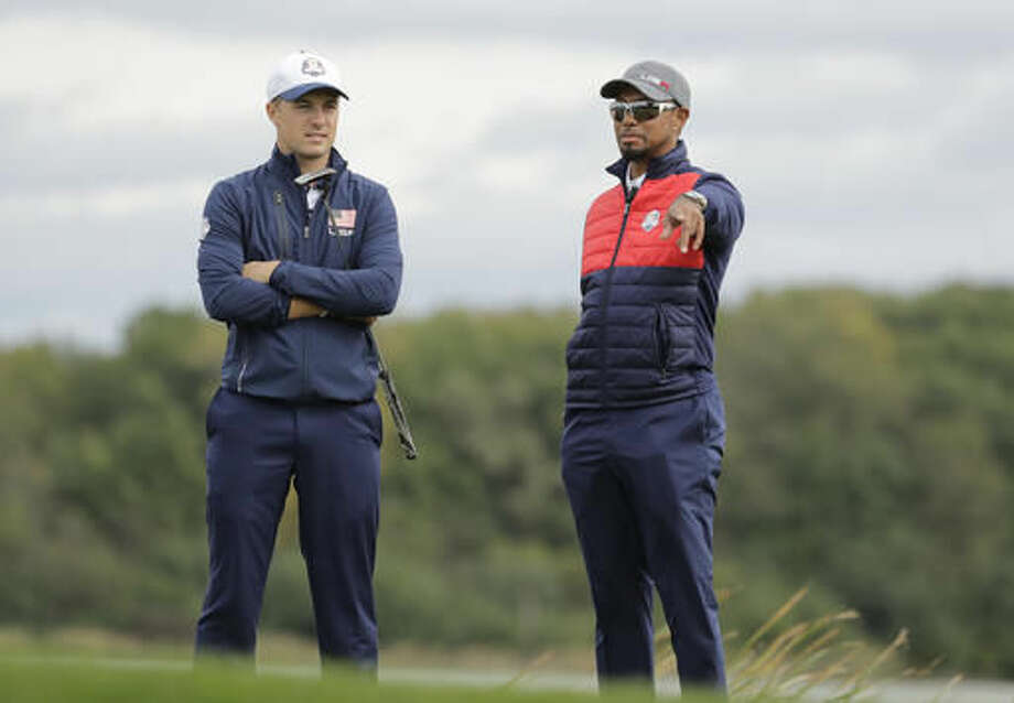 United States vice-captain Tiger Woods talks to United States' Jordan Spieth on the seventh hole during a practice round for the Ryder Cup golf tournament Tuesday, Sept. 27, 2016, at Hazeltine National Golf Club in Chaska, Minn. (AP Photo/Charlie Riedel)